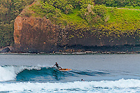 Anini Beach paddle board surfer.  Anini Beach is one of the many gems of the island of Kauai, Hawii