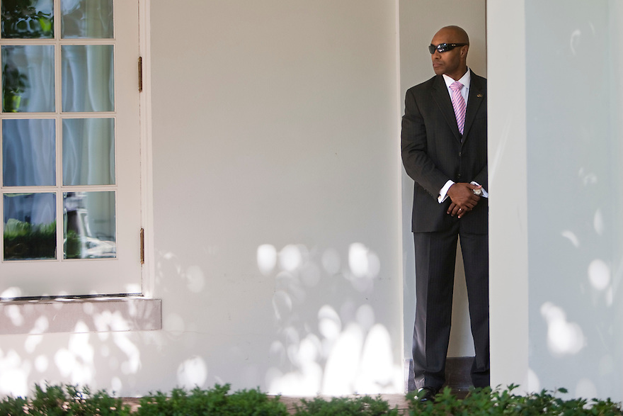 A Secret Service agent watches as President Barack Obama speaks on extending unemployment insurance, in the Rose Garden of the White House in Washington.