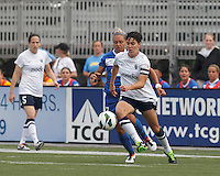 Seattle Reign FC midfielder Keelin Winters (11) controls the ball as Boston Breakers forward Kyah Simon (17) pressures. In a National Women's Soccer League (NWSL) match, Seattle Reign FC (white) defeated Boston Breakers (blue), 2-1, at Dilboy Stadium on June 26, 2013.