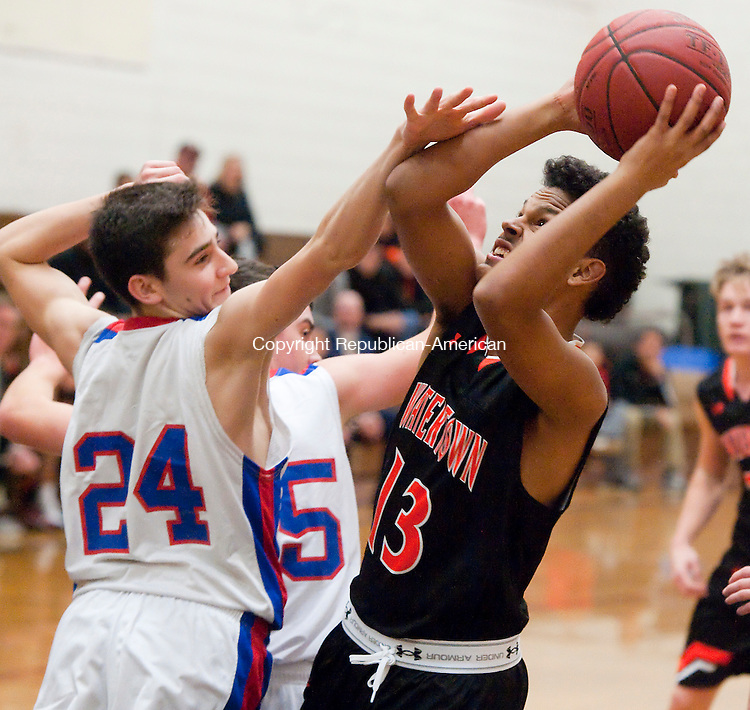 WOODBURY,  CT-122816JS23--Watertown's Tyson Torsiello  (13) gets fouled by Nonnewaug's Ryan Cleary (24) while putting up a shot Watertown's during the Nonnewaug Holiday Tournament held Wednesday at Nonnewaug High School in Woodbury. <br /> Jim Shannon Republican-American