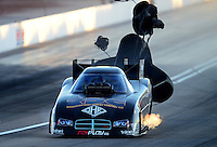 Oct. 26, 2012; Las Vegas, NV, USA: NHRA funny car driver Jon Capps during qualifying for the Big O Tires Nationals at The Strip in Las Vegas. Mandatory Credit: Mark J. Rebilas-