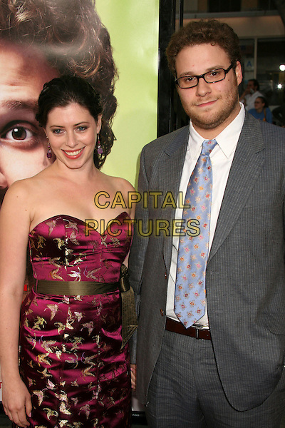 "SETH ROGEN & GUEST.""Knocked Up"" Los Angeles Premiere at Mann's Village Theatre, Westwood, California, USA..May 21st, 2007.half length grey gray suit purple dress strapless ribbon bow.CAP/ADM/BP.©Byron Purvis/AdMedia/Capital Pictures"