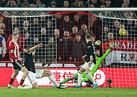 24th November 2019; Bramall Lane, Sheffield, Yorkshire, England; English Premier League Football, Sheffield United versus Manchester United; Oliver McBurnie of Sheffield United scores in the 90th minute to make it 3-3 beating David De Gea of Manchester United after a VAR decision  - Strictly Editorial Use Only. No use with unauthorized audio, video, data, fixture lists, club/league logos or 'live' services. Online in-match use limited to 120 images, no video emulation. No use in betting, games or single club/league/player publications