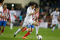 11.04.2012 MADRID, SPAIN - La Liga match played between At. Madrid vs Real Madrid (1-4) with hat-trick of Cristiano Ronaldo at Vicente Calderon stadium. The picture show Angel di Maria (Argentine midfielder of Real Madrid) and  Filipe Luis Karsmirski (Brazilian defender of At. Madrid)