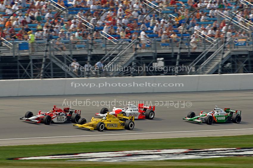 11 September, 2005, Joliet,IL,USA<br /> Dan Wheldon leads #4 Tomas Schekter, #6 Sam Hornish, Jr. and #11 Tony Kanaan.<br /> Copyright&copy;F.Peirce Williams 2005