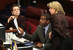 Nevada Sens. Valerie Wiener, D-Las Vegas, Steven Horsford, D-North Las Vegas, and Barbara Cegavske, R-Las Vegas, work on the Senate floor on Thursday, April 7, 2011, at the Legislature in Carson City, Nev..Photo by Cathleen Allison