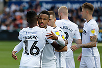(L-R) Joel Asoro of Swansea City is embraced by Martin Olsson prior to the Sky Bet Championship match between Swansea City and Bristol City at the Liberty Stadium, Swansea, Wales, UK. Saturday 25 August 2018