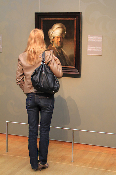 Woman viewing painting at the Rjikmuseum in Amsterdam, Netherlands .  John offers private photo tours in Denver, Boulder and throughout Colorado, USA.  Year-round. .  John offers private photo tours in Denver, Boulder and throughout Colorado. Year-round.