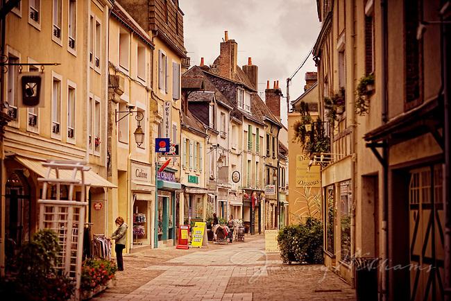 A narrow street in the town of Ferte Benard in France