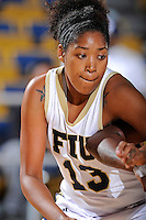 25 November 2011:  FIU forward-center Diamond Ashmore (13) battles for position on a rebound in the first half as the University of Maryland Terrapins defeated the FIU Golden Panthers, 84-52, at the U.S. Century Bank Arena in Miami, Florida.