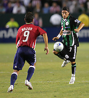 Santos forward Walter Jimenez (7) moves in on Chivas USA forward Ante Razov (9). Chivas USA defeated the Santos of Laguna 1-0 during the 1st round of the 2008 SuperLiga at Home Depot Center stadium, in Carson, California on Wednesday, July 16, 2008.