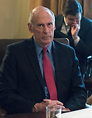 Director of National Intelligence Dan Coats listens as United States President Donald J. Trump makes opening remarks during a Cabinet meeting in the Cabinet Room of the White House in Washington, DC on Wednesday, January 10, 2018.<br /> Credit: Ron Sachs / Pool via CNP