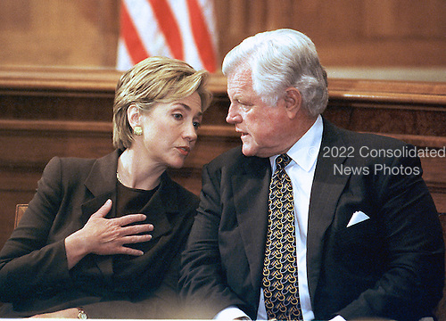 """First lady Hillary Rodham Clinton and United States Senator Edward M. """"Ted"""" Kennedy (Democrat of Massachusetts) talk to one another during a Capitol Hill press conference on September 28, 1999 in Washington, DC.  The press conference was called to discuss a new study by the Economic Policy Institute on the impact a minimum-wage increase would have on working women.  Both favor the increase.<br /> Credit: Ron Sachs / CNP"""