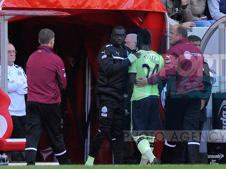 Newcastle United's Cheik Tiote (C) walks down the tunnel after being sent off and is consoled by team mate Newcastle United's Papiss Cisse (L).Barclays Premier League - Sunderland vs Newcastle Utd - Stadium of Light - Sunderland - 21/10/12 - Picture Richard Lee/Sportimage
