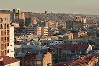 Armenia. Yerevan. Sunset on the city center. Old and new buildings. Some constructions are dating from Soviet time. Ameria sign. Yerevan, sometimes spelled Erevan, is the capital and largest city of Armenia. 1.10.2019 © 2019 Didier Ruef
