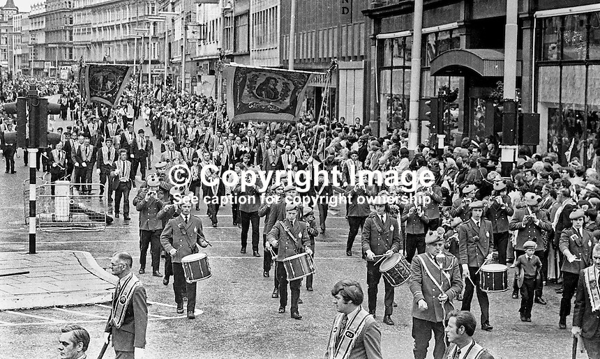 Orangemen take part in Twelfth Parade in Belfast, N Ireland, UK. NI Troubles. N Ireland Troubles. Band. Banners. Ref: 197307021.<br /> <br /> Copyright Image from Victor Patterson, 54 Dorchester Park, Belfast, UK, BT9 6RJ<br /> <br /> t: +44 28 90661296<br /> m: +44 7802 353836<br /> vm: +44 20 88167153<br /> e1: victorpatterson@me.com<br /> e2: victorpatterson@gmail.com<br /> <br /> For my Terms and Conditions of Use go to www.victorpatterson.com