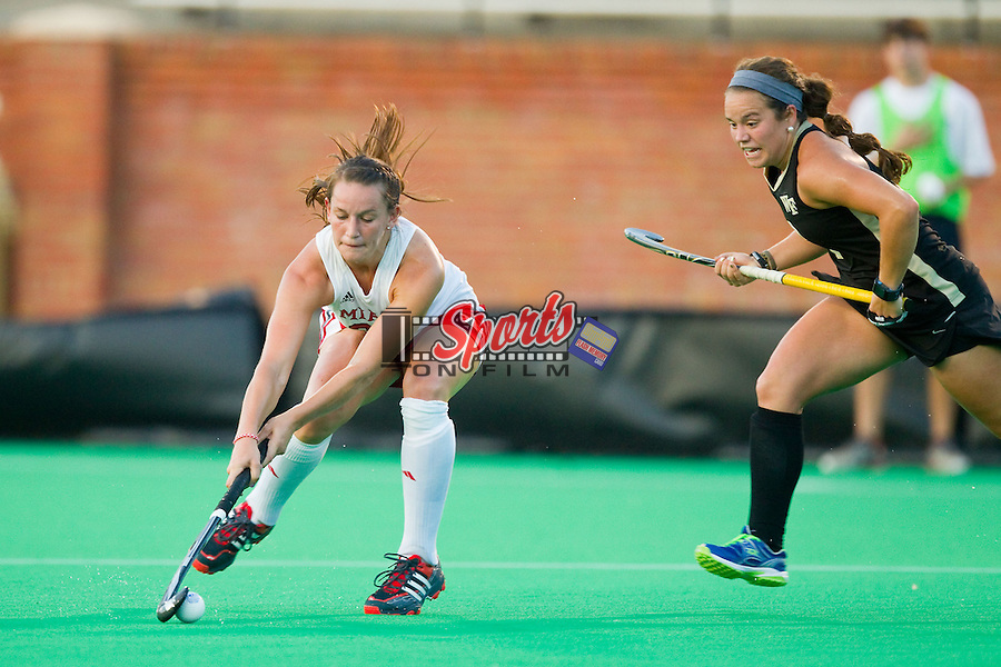Ali Froede (28) of the Miami RedHawks controls the ball in front of Kari Walkley (6) of the Wake Forest Demon Deacons during first half action at Kentner Stadium on August 30, 2013 in Winston-Salem, North Carolina.  The Demon Deacons defeated the RedHawks 3-2.  (Brian Westerholt/Sports On Film)
