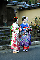 """Geisha on the streets of Arashiyama - geiko as they are called in Kyoto, are traditionally entertainers whose skills include performing various Japanese arts such as classical music and dance. Apprentice geisha are called maiko literally """"dance child""""."""