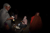 Women buy some goods at the main market in Baidoa, Somalia on Wednesday January 03 2007..Only a few days after the fall of the United Islamic Courts in Mogadishu, Ethiopian and Transitional Federal Government troops are patrolling the city and securing strategic locations..The people in Mogadishu appear confused and doubtful on t