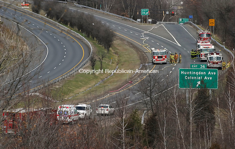 WATERBURY, CT 4/8/07- 040807BZ06- The Waterbury Fire Department and several mutual aid departments converged on Rte. 8 northbound after a tractor trailer, reportedly carrying gasoline, overturned between exits 35 and 36 Easter Sunday.<br /> Jamison C. Bazinet Republican-American