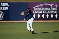AZL Brewers Blue center fielder Terence Doston (9) throws to second base during an Arizona League game against the AZL Athletics Gold on July 2, 2019 at American Family Fields of Phoenix in Phoenix, Arizona. AZL Athletics Gold defeated the AZL Brewers Blue 11-8. (Zachary Lucy/Four Seam Images)