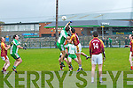 The Bernard O'Callaghan Memorial Senior Football Championship 2013, Round 1 Ballyduff (white/green) V Duagh (Red) which took place on Sunday in Frank Sheehy Park, Listowel.  Referee: Billy McElligot, Listowel Emmets.<br /> <br /> Ballyduff's Sean Brown and Peter Sheeran of Duagh challenging each other for the ball.