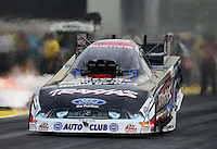 Sept. 28, 2012; Madison, IL, USA: NHRA funny car driver Courtney Force during qualifying for the Midwest Nationals at Gateway Motorsports Park. Mandatory Credit: Mark J. Rebilas-