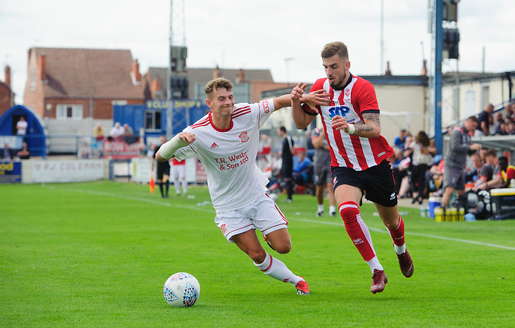 Lincoln City's trialist vies for possession with Lincoln United's Charlie West<br /> <br /> Photographer Chris Vaughan/CameraSport<br /> <br /> Football Pre-Season Friendly (Community Festival of Lincolnshire) - Lincoln City v Lincoln United - Saturday 6th July 2019 - The Martin & Co Arena - Gainsborough<br /> <br /> World Copyright © 2018 CameraSport. All rights reserved. 43 Linden Ave. Countesthorpe. Leicester. England. LE8 5PG - Tel: +44 (0) 116 277 4147 - admin@camerasport.com - www.camerasport.com
