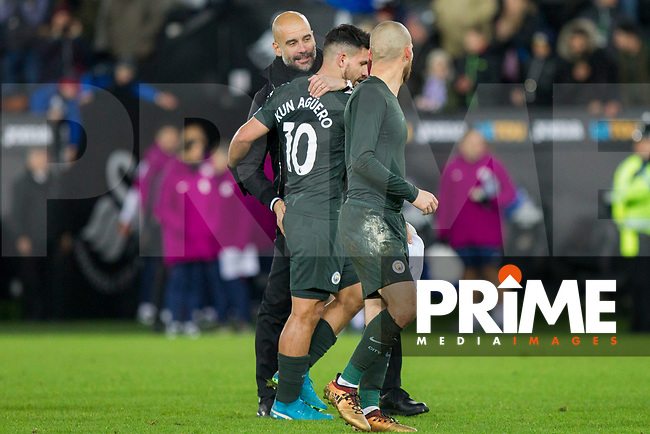 Manchester City manager Pep Guardiola congratulates Sergio Aguero at full time of the EPL - Premier League match between Swansea City and Manchester City at the Liberty Stadium, Swansea, Wales on 13 December 2017. Photo by Mark  Hawkins / PRiME Media Images.