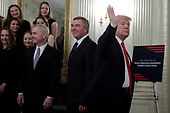 United States President Donald J. Trump waves to reporters after greeting college athletes as part of NCAA Collegiate National Champions Day at the White House in Washington on November 22, 2019. <br /> Credit: Yuri Gripas / Pool via CNP
