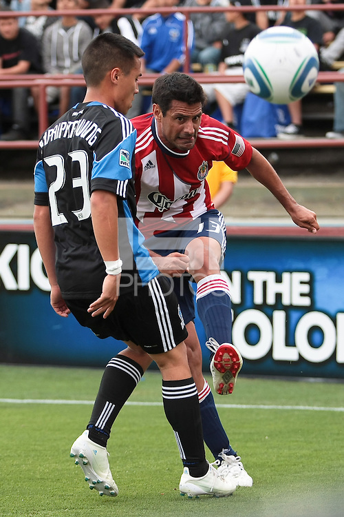 Ante Jazic (13) kicks the ball against Anthony Ampaipitakwong (23). Chivas USA defeated the San Jose Earthquakes 2-1 at Buck Shaw Stadium in Santa Clara, California on April 23rd, 2011.