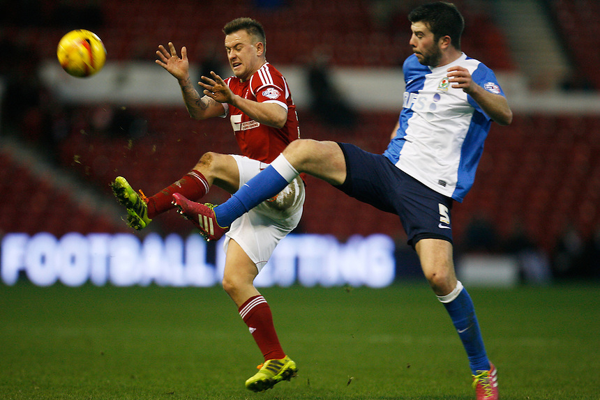 Nottingham Forest's Simon Cox (L) and Blackburn's Grant Hanley in action during todays match  <br /> <br /> Photo by Jack Phillips/CameraSport<br /> <br /> Football - The Football League Sky Bet Championship - Nottingham Forest v Blackburn Rovers - Saturday 18th January 2014 - The City Ground - Nottingham<br /> <br /> &copy; CameraSport - 43 Linden Ave. Countesthorpe. Leicester. England. LE8 5PG - Tel: +44 (0) 116 277 4147 - admin@camerasport.com - www.camerasport.com