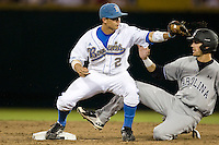 UCLA SS Niko Gallego forces South Carolina's Bobby Haney in Game One of the NCAA Division One Men's College World Series Finals on June 28th, 2010 at Johnny Rosenblatt Stadium in Omaha, Nebraska.  (Photo by Andrew Woolley / Four Seam Images)