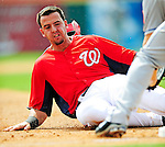 1 March 2011: Washington Nationals' first baseman Chris Marrero slides into third during a Spring Training game against the New York Mets at Space Coast Stadium in Viera, Florida. The Nationals defeated the Mets 5-3 in Grapefruit League action. Mandatory Credit: Ed Wolfstein Photo