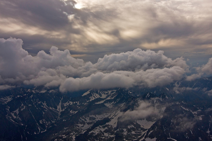 Aerial view of mountain peaks under clouds. High Tatras, Slovakia. June 2009. Mission: Ticha