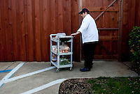 Private chef Brent Moore (cq) brings food between fraternity houses before dinner a prime rib dinner at the Sigma Alpha Epsilon fraternity house on the Southern Methodist University campus in Dallas, Texas, Friday, january 20, 2011. Some high-end chefs have found professional salvation from an unlikely location: Fraternity Row. ..Matt Nager for The Wall Street Journal