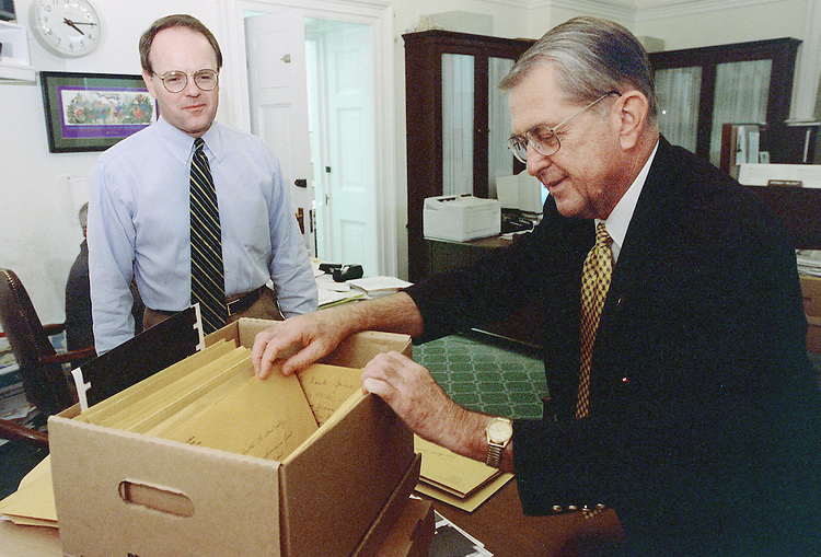10/14/98.SOLOMON--Aide Dave Lonie, left, shows pictures to Rules Committee Chairman Gerald Solomon, R-N.Y., who is retiring at the end of this session, taken of the chairman during his career in the House. Lonie is in the process of archiving boxes of Solomon's papers, including the pictures, which will be given to a college or univeristy library in his home district. Solomon was first elected to the House in 1979..CONGRESSIONAL QUARTERLY PHOTO BY SCOTT J. FERRELL