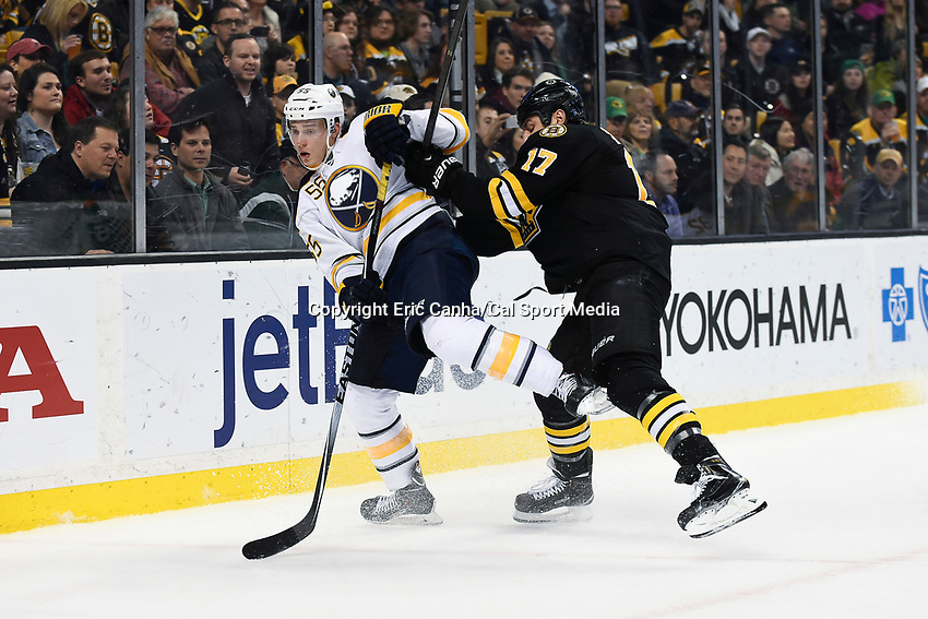 March 17, 2015 - Boston, Massachusetts, U.S. - Boston Bruins left wing Milan Lucic (17) and Buffalo Sabres defenseman Rasmus Ristolainen (55) in game action during the NHL match between the Buffalo Sabres and the Boston Bruins held at TD Garden in Boston Massachusetts. Buffalo defeated Boston 2-1 by shoot out. Eric Canha/CSM