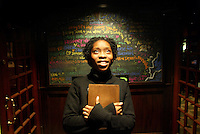 Cambridge, MA - Slam poet Iyeoka Okoawoat the Lizard Lounge entrance where she will be part of a poetry slam.