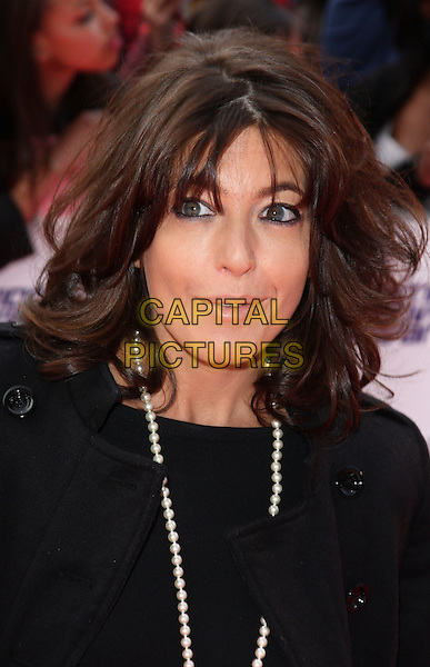 CLAUDIA WINKLEMAN .National Movie Awards 2010 at the Royal Festival Hall, London, England,  May 26th 2010..arrivals portrait headshot eyeliner make-up  black pearl necklace mouth open .CAP/ROS.©Steve Ross/Capital Pictures.
