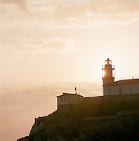 The lighthouse on a clifftop at Cudillero, Asturias, Spain