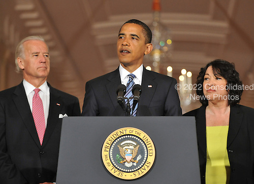 Washington, D.C. - May 26, 2009 -- United States President Barack Obama names Judge Sonia Sotomayor of the Federal Appeals Court as his nominee for Justice of the U.S. Supreme Court  in the East Room of the White House on Tuesday, May 26, 2009.  She will replace retiring Justice David Souter. Judge Sotomayor, 54, of The Bronx, New York, will be the first Hispanic to serve if her nomination is approved by the U.S. Senate.  From left to right: Vice President Joseph Biden, President Obama, and Judge Sotomayor..Credit: Ron Sachs / Pool via CNP