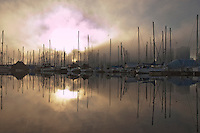 Reflections of yachts and masts in the late afternoon,English bay, Stanley Park, Vancouver, Canada