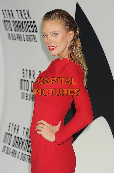 Bar Paly<br /> &quot;Star Trek Into Darkness&quot; DVD/Blu-Ray Release held at the California Science Center, Los Angeles, California, USA.<br /> September 10th, 2013<br /> half length dress hand on hip red hair slicked back side lipstick <br /> CAP/ROT/TM<br /> &copy;Tony Michaels/Roth Stock/Capital Pictures