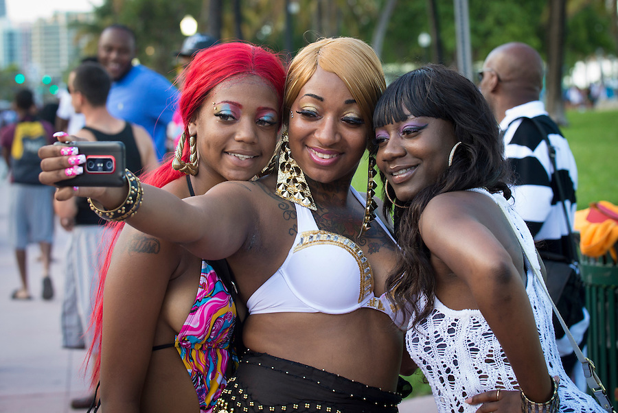 MIAMI - May 26, 2012: Group of friends having fun and taking photos during the Miami Beach Urban Weekend, this is the largest Urban Festival in the World, that caters towards the Hip Hop Generation. Over 300.000 participants make the annual trek to South Beach for 4 days full of fun, food, festivities, entertainment, music, and more.