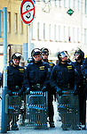 Riot police protect  delegates of the World Bank and IMF conference as Protesters against  globalization  gather in Prague to protest  against their annual meeeitng.