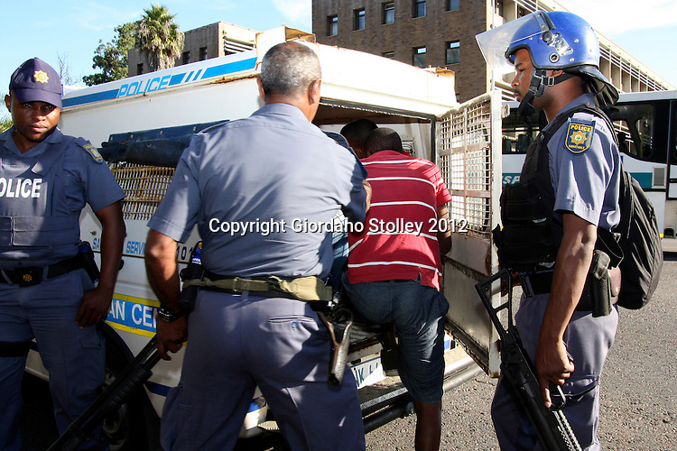 DURBAN - 18 May 2012 - A protesting taxi driver is bundled into the back of a police van near the Durban Magistrates Court. They were demanding the release of their compatriots, who were arrested on Thursday during protests against the eThekwini Metro police..Picture: Giordano Stolley/Allied Picture Press/APP