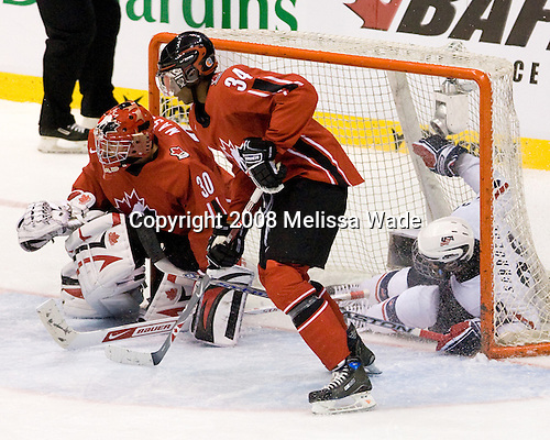 Jordan Schroeder (USA 29) goes into the net behind Steve Mason (Canada 30) and Wayne Simmonds (Canada 34). Team Canada defeated Team USA 4-1 on Friday, January 4, 2008, during the World Junior Championship at CEZ Arena in Pardubice, Czech Republic.  The result put Team Canada into the gold medal game and Team USA into the bronze medal game.