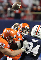 ATLANTA, GA - DECEMBER 31: Michael Rocco #16 of the Virginia Cavaliers handles the ball during the 2011 Chick Fil-A Bowl against the Auburn Tigers at the Georgia Dome on December 31, 2011 in Atlanta, Georgia. Auburn defeated Virginia 43-24. (Photo by Andrew Shurtleff/Getty Images) *** Local Caption *** Michael Rocco