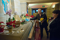 After the last visitors have exited, volunteers remove flowers from the tomb of St. Katharine Drexel at the National Shrine of St. Katharine Drexel Saturday, December 30, 2017 in Bensalem, Pennsylvania. Drexel was an American heiress who dedicating herself to work among the American Indians and African-Americans in the western and southwestern United States. She was canonized a saint by the Roman Catholic Church in 2000. (Photo by William Thomas Cain/Cain Images)